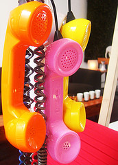 three-old-time-phones-yellow-pink-orange